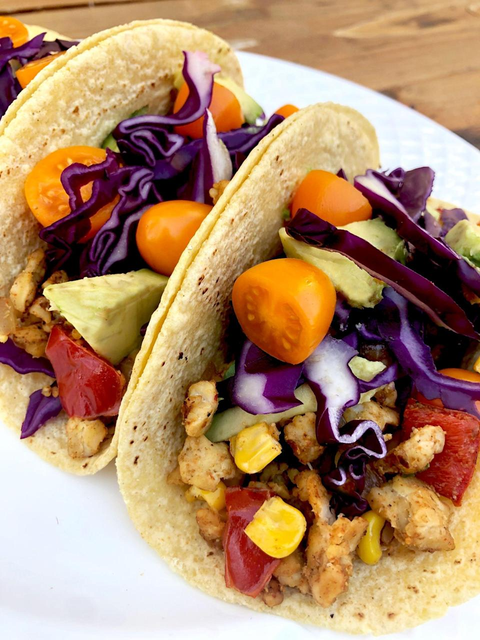"""<p>These tempeh tacos are so easy to make and so satisfying, you'll wish it was Taco Tuesday every night. The filling is made with crumbled tempeh, sautéed onions, red peppers, and corn. It's perfectly soft and tender, and slightly spicy - even meat eaters will be instant fans! </p> <p><strong>Get the recipe:</strong> <a href=""""https://www.popsugar.com/fitness/Tempeh-Taco-Recipe-45938997"""" class=""""link rapid-noclick-resp"""" rel=""""nofollow noopener"""" target=""""_blank"""" data-ylk=""""slk:tempeh tacos"""">tempeh tacos</a></p>"""