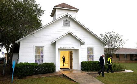 A member of the media walks inside the First Baptist Church of Sutherland Springs where 26 people were killed one week ago, as the church opens to the public as a memorial to those killed, in Sutherland Springs, Texas, U.S. November 12, 2017.  REUTERS/Rick Wilking