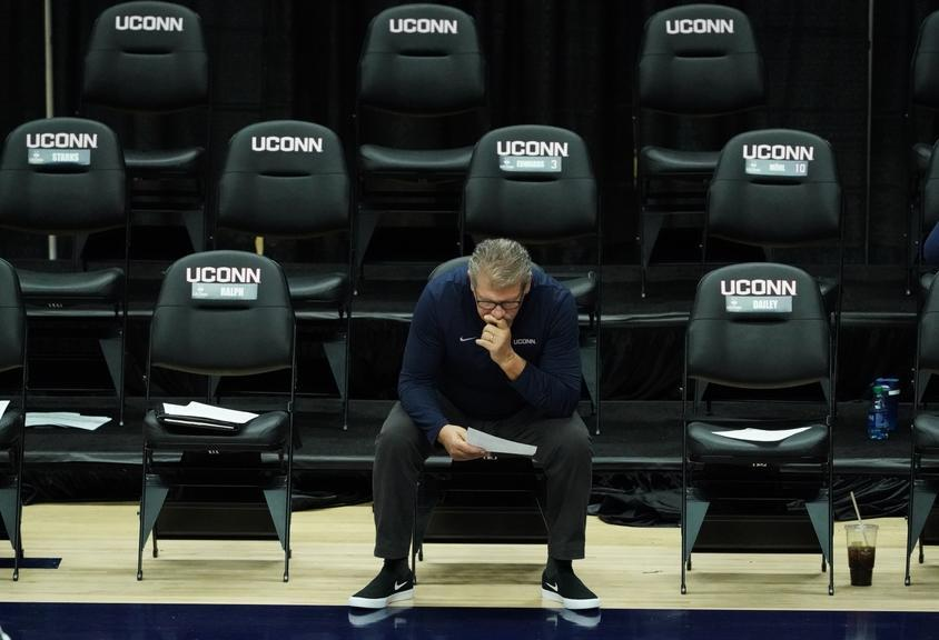 Geno Auriemma sits by himself pre-game