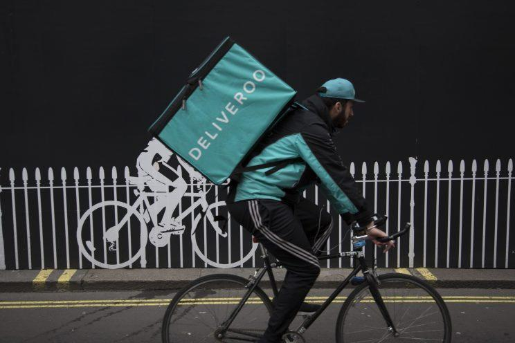 Deliveroo has a way of talking to its riders... (Mike Kemp/In Pictures via Getty Images)