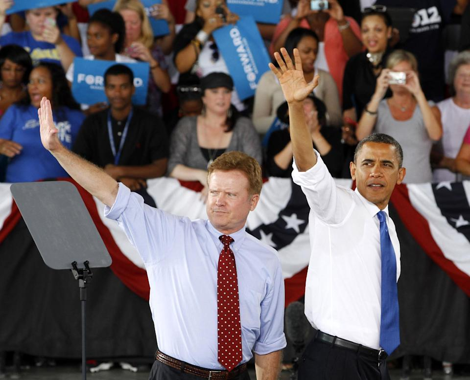 FILE - In this Sept, 27, 2012 file photo, President Barack Obama, accompanied by retiring Sen. Jim Webb, D-Va., left, waves to supporters during a campaign rally in Virginia Beach, Va. This year, the presidential race may come down to an even narrower slice of the electorate than simply the nine states where both Obama and Romney are aggressively competing: Florida, Ohio, Virginia, Colorado, Iowa, Nevada, New Hampshire, North Carolina and Wisconsin. (AP Photo/Steve Helber, File)