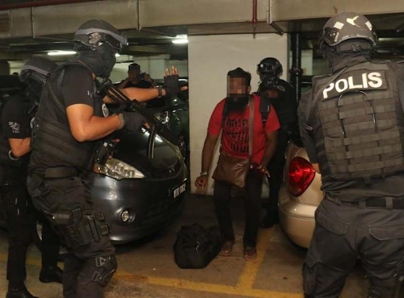 Counter-terrorism police carry out an operation against suspected Liberation Tigers of Tamil Eelam (LTTE) sympathisers in Segamat October 10, 2019. — Picture courtesy of PDRM
