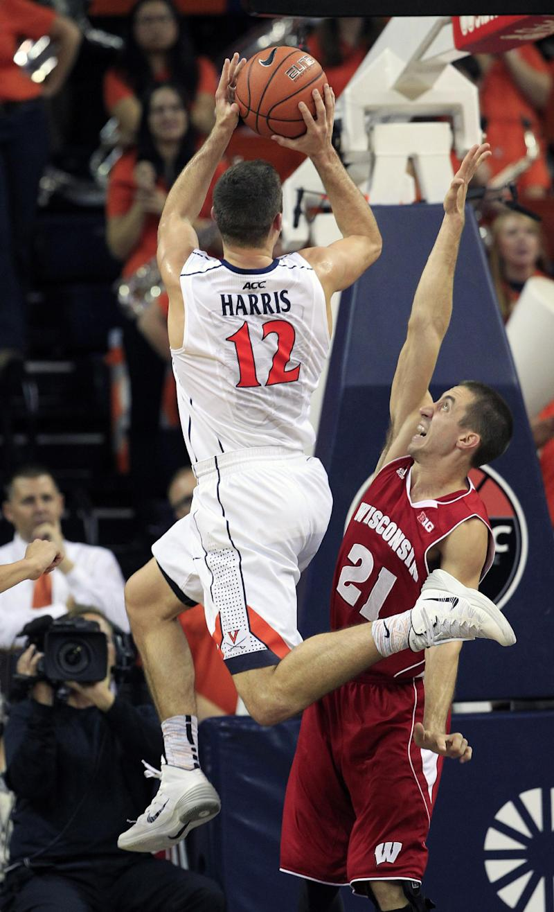 Harris, Virginia miss, No. 8 Wisconsin wins 48-38