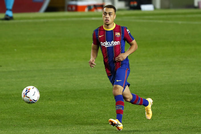 Sergiño Dest doesn't want to just be the first American player to appear for Barcelona's vaunted first team. (AP Photo/Joan Monfort)