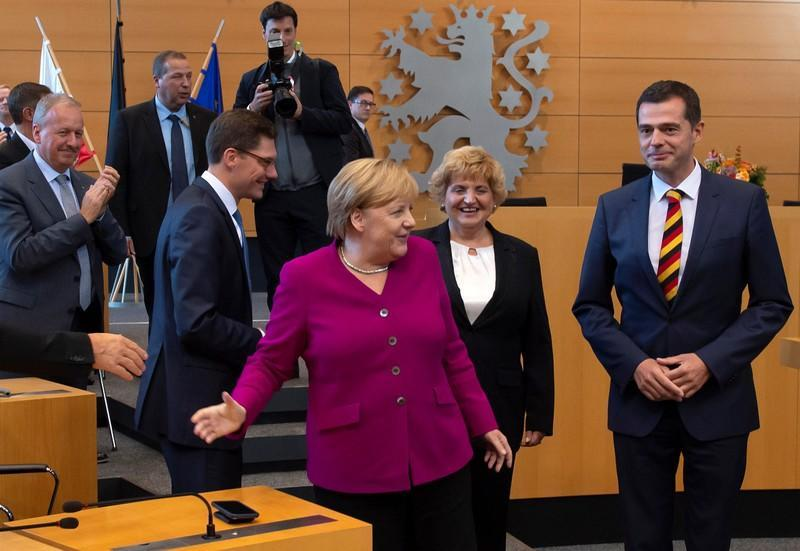 German Chancellor Angela Merkel attends a celebration event of the CDU Parliamentary Group in the State Parliament Thuringia for the Day of German Unity in the state parliament building in Erfurt