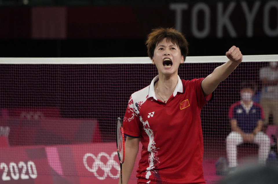 China's Chen Yu Fei celebrates after winning against Tai Tzu-Ying of Taiwan during their women's singles badminton gold medal match at the 2020 Summer Olympics, Sunday, Aug. 1, 2021, in Tokyo, Japan. (AP Photo/Markus Schreiber)
