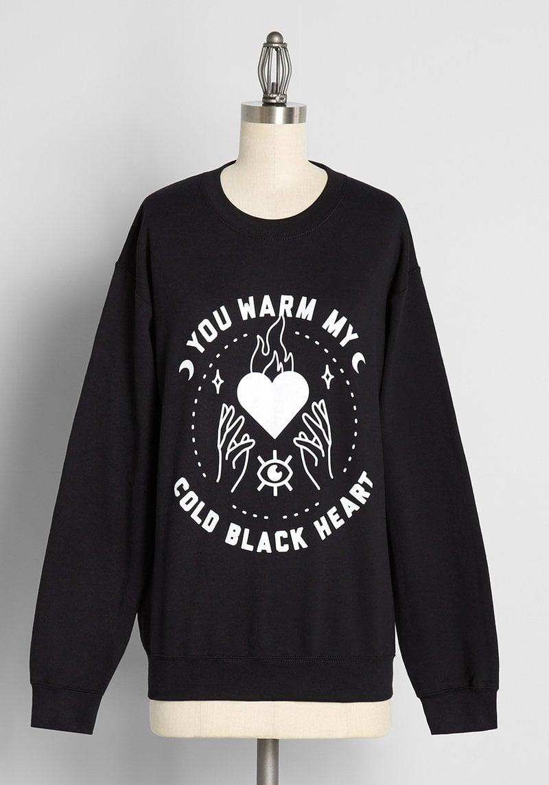 <p>Embrace your inner good witch and sport the <span>My Cold Black Heart Graphic Sweatshirt</span> ($49). It's a cute, casual, and cozy oversize sweatshirt perfect for the fall.</p>
