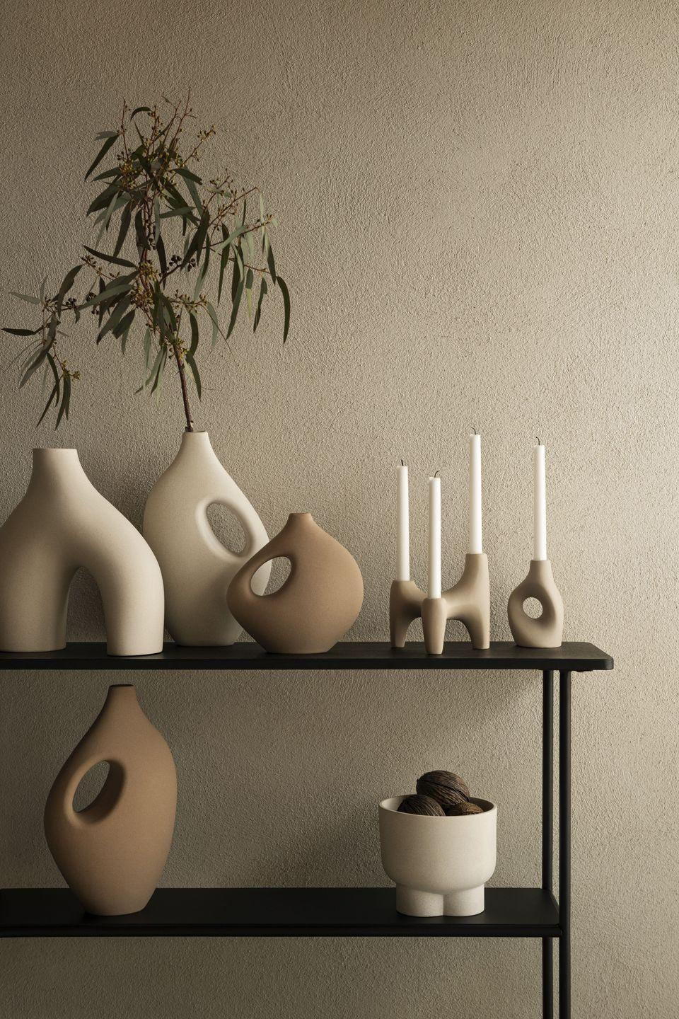 """<p>Create art out of your vases by adding these beautifully glazed ceramic pieces in random groupings around your home. Not only will they add an artistic touch, but they'll also mean you can get away with fewer pieces of art on the walls, helping to set up an inviting, decluttered space to relax in. </p><p><a class=""""link rapid-noclick-resp"""" href=""""https://go.redirectingat.com?id=127X1599956&url=https%3A%2F%2Fwww2.hm.com%2Fen_gb%2Fhome%2Fshop-by-product%2Fdecorations.html&sref=https%3A%2F%2Fwww.prima.co.uk%2Fhome-ideas%2Fhome-accessories-buys%2Fg37325647%2Fhandm-home-autumn-collection%2F"""" rel=""""nofollow noopener"""" target=""""_blank"""" data-ylk=""""slk:Shop home decor at H&M"""">Shop home decor at H&M</a></p>"""