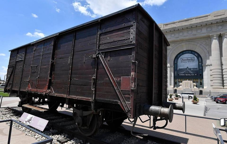 An authentic German-made railway freight car stands in front of Kansas City's Union Station. Before World War II, it was used to transport food, goods and livestock. During the war, cars like this carried Jews and others to ghettos and Nazi concentration camps across Europe, including Auschwitz.