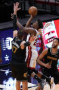 Miami Heat forward Jimmy Butler (22) drives to the basket over Memphis Grizzlies center Jonas Valanciunas (17) and forward Kyle Anderson (1), during the second half of an NBA basketball game, Tuesday, April 6, 2021, in Miami. (AP Photo/Marta Lavandier)