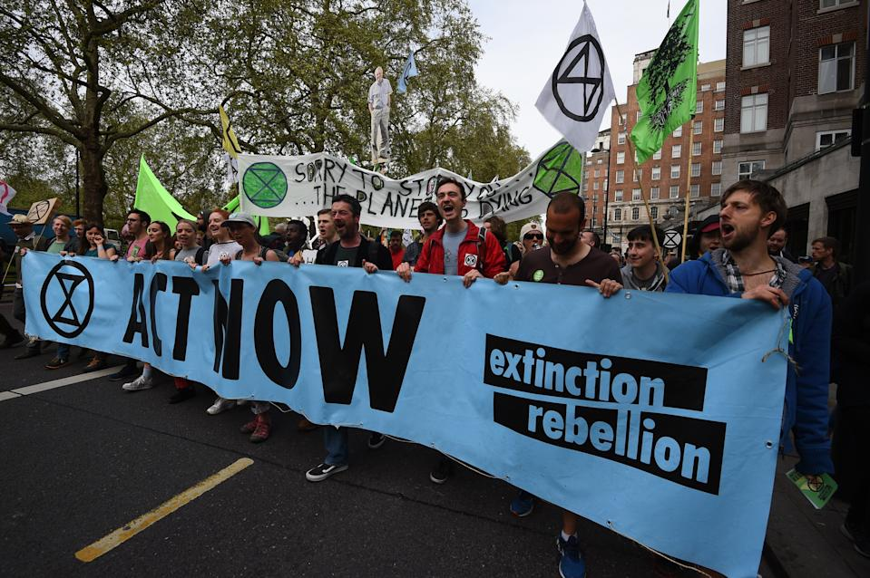 Extinction Rebellion protesters march from their camp in Marble Arch down Park Lane in London. More than 1,000 people have been arrested during the climate change protests in London as police cleared the roadblocks responsible for disruption in the capital.
