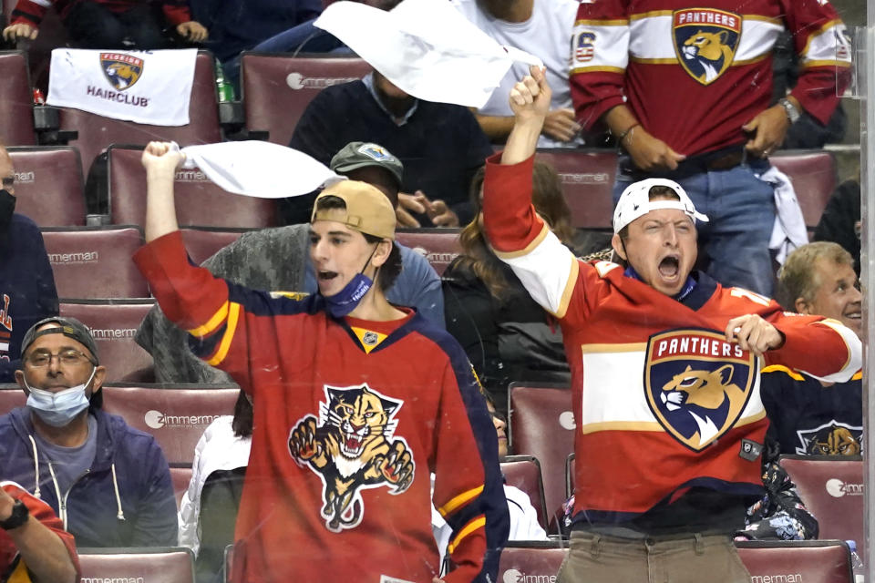Florida Panthers fans cheer during the second period in Game 2 of the team's NHL hockey Stanley Cup first-round playoff series against the Tampa Bay Lightning, Tuesday, May 18, 2021, in Sunrise, Fla. (AP Photo/Lynne Sladky)