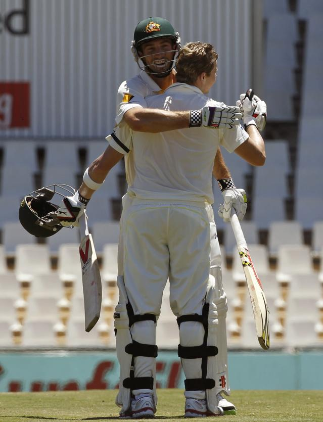 Australia's Steve Smith (front) is congratulated by teammate Shaun Marsh after he completed his century during the second day of their cricket test match against South Africa in Centurion February 13, 2014. REUTERS/Siphiwe Sibeko (SOUTH AFRICA - Tags: SPORT CRICKET)