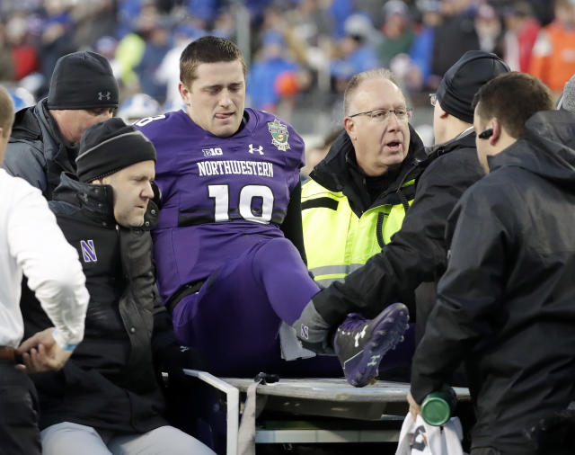 "Northwestern quarterback <a class=""link rapid-noclick-resp"" href=""/ncaaf/players/240723/"" data-ylk=""slk:Clayton Thorson"">Clayton Thorson</a> (18) is put on a cart to be taken off the field after being injured in the first half of the Music City Bowl NCAA college football game against Kentucky, Friday, Dec. 29, 2017, in Nashville, Tenn. (AP Photo/Mark Humphrey)"