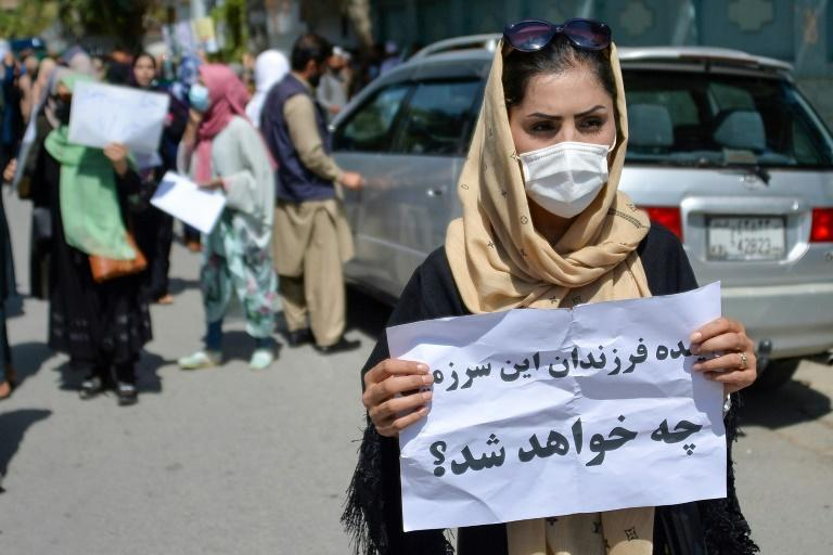 An Afghan woman displays a placard during the demonstrations (AFP/Hoshang Hashimi)