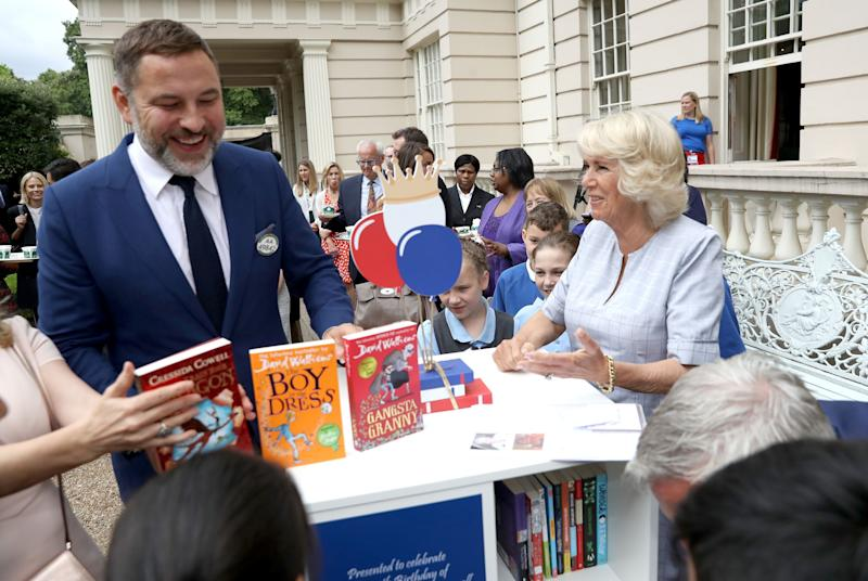 EMBARGOED TO 0001 THURSDAY MAY 21 File photo dated 11/7/2017 of comedian and author David Walliams during a tea party hosted by the Duchess of Cornwall to celebrate The Duchess's Bookshelves project. The pair spoke during their video chat to highlight the Queen's Commonwealth Essay Competition and they discussed how writing stories is perfect for passing the time in lockdown. PA Photo. Issue date: Thursday May 21, 2020. See PA story ROYAL Camilla. Photo credit should read: Chris Jackson/PA Wire