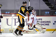 Pittsburgh Penguins' Marcus Pettersson (28) celebrates his goal against Washington Capitals goaltender Ilya Samsonov (30) during the second period of an NHL hockey game in Pittsburgh, Sunday, Jan. 17, 2021. (AP Photo/Gene J. Puskar)