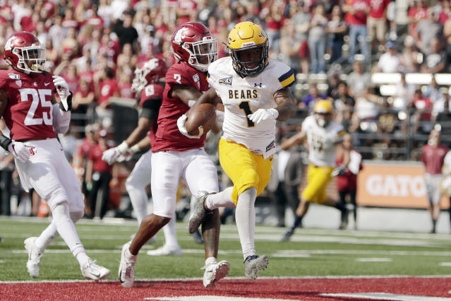 Northern Colorado running back Milo Hall (1) runs for a touchdown in front of Washington State defensive back Daniel Isom (3) during the first half of an NCAA college football game in Pullman, Wash., Saturday, Sept. 7, 2019. (AP Photo/Young Kwak)