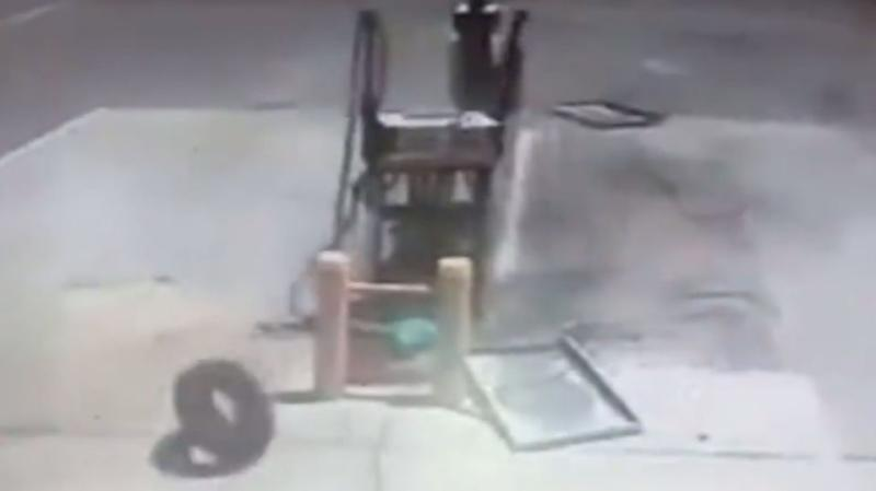 A wheel from one of the vehicles rolls past the petrol pump. Photo: 7 News