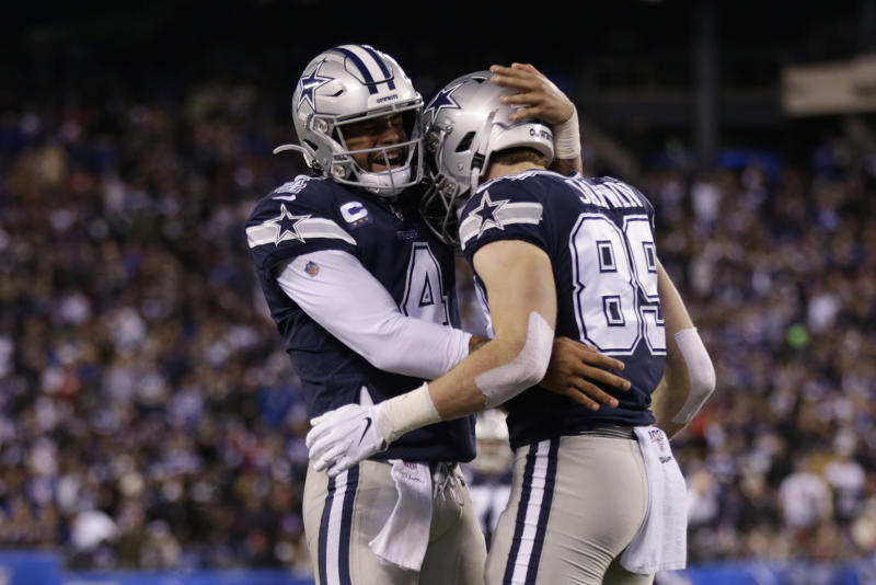 Dallas Cowboys quarterback Dak Prescott (4) celebrates with tight end Blake Jarwin (89) after Jarwin scored a touchdown against the New York Giants last season. (AP Photo/Adam Hunger)