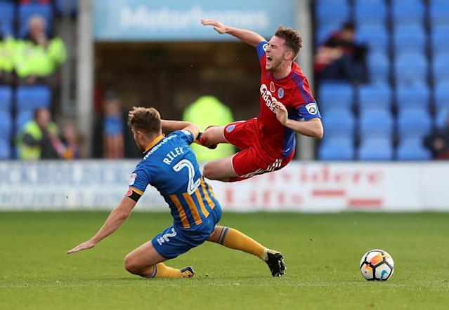 Soccer Football - FA Cup First Round - Shrewsbury Town vs Aldershot Town - New Meadow, Shrewsbury, Britain - November 4, 2017 Aldershot Town's Jim Kellermann is fouled by Shrewsbury Town's Joe Riley Action Images/John Clifton