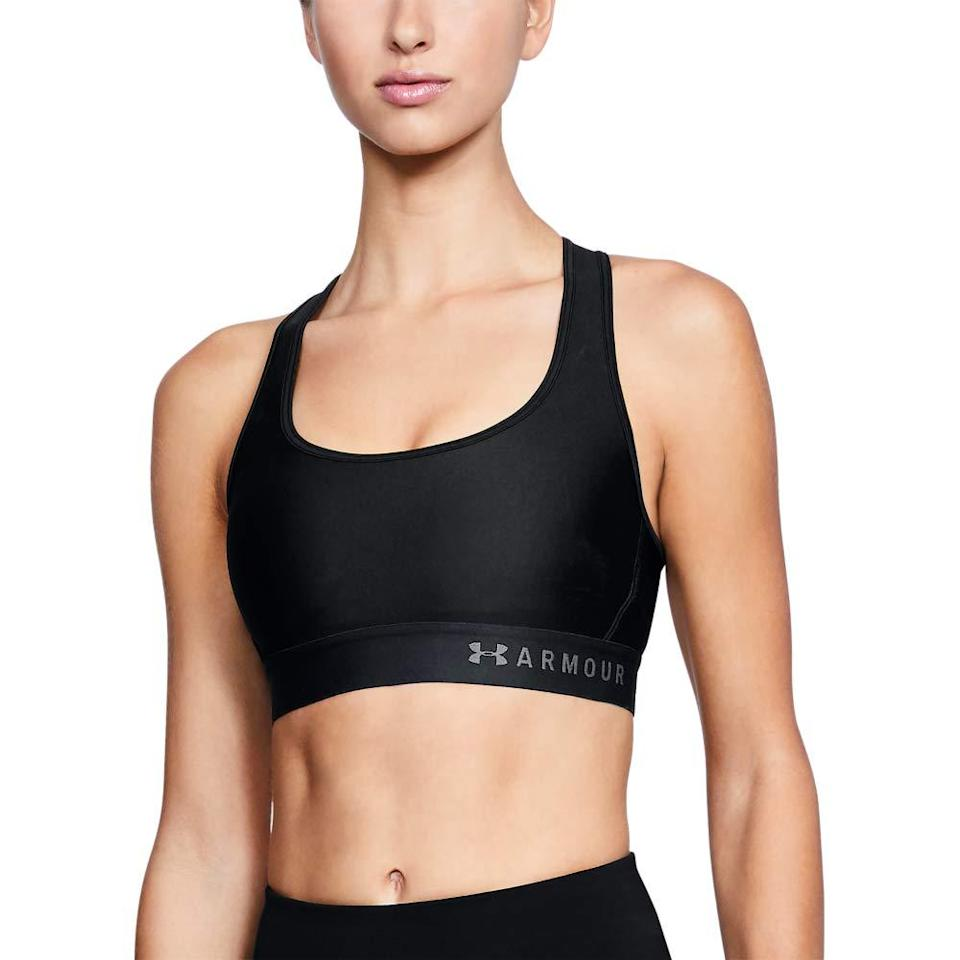 "<h3>Under Armour HeatGear Mid Impact Crossback Sports Bra</h3><br>Under Armour's polyester-elastane blend bra wicks sweat like a champ and dries quickly post hand-washing. Plus, the keyhole back is like a built-in AC unit.<br><br><strong>Under Armour</strong> HeatGear Mid Impact Crossback Sports Bra, $, available at <a href=""https://amzn.to/2I5fUZA"" rel=""nofollow noopener"" target=""_blank"" data-ylk=""slk:Amazon"" class=""link rapid-noclick-resp"">Amazon</a>"
