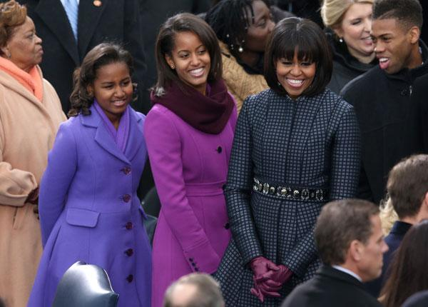 The First Lady accessorizes with a stunning J. Crew belt to go along with her daughters' J. Crew jackets. (Photo by Mark Wilson/Getty Images)