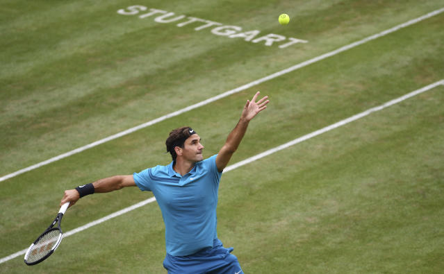 Roger Federer serves to Mischa Zverev during their match, at the ATP Mercedes Cup tournament in Stuttgart, Germany, Wednesday, June 13, 2018. (Marijan Murat/dpa via AP)
