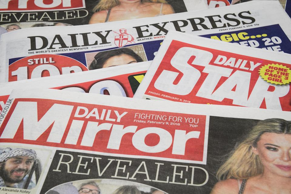 LONDON, ENGLAND - FEBRUARY 09:  Issues of the Daily Mirror, Daily Star and Daily Express are seen on February 9, 2018 in London, England.  The Trinity Mirror media group has agreed to pay £126.7m for Northern & Shell, the media company which publishes the Express and Star newspapers, as well as magazines OK!, New! and Star.  (Photo Illustration by Leon Neal/Getty Images)
