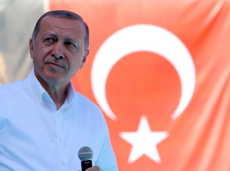 Wrapping yourself in the flag is an age-old political tactic. Analysts say President Recep Tayyip Erdogan is exploiting a bitter row with the United States to pin the blame for Turkey's increasingly acute economic troubles on an external enemy (AFP Photo/ADEM ALTAN)