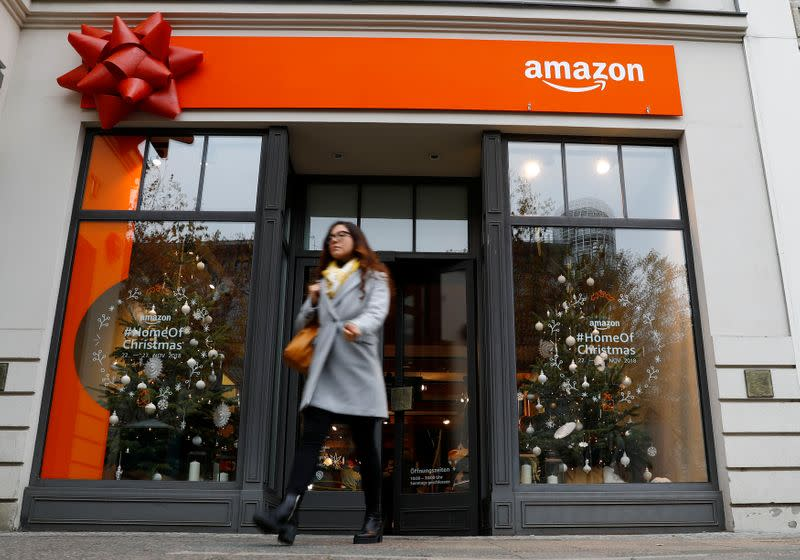 A customer leaves a new Amazon pop-up store for Christmas at Berlin's main shopping street Kurfurstendamm boulevard in Berlin