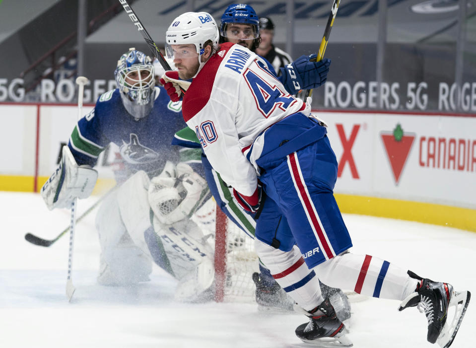 Montreal Canadiens right wing Joel Armia (40) fails to get a shot past Vancouver Canucks goaltender Braden Holtby (49) during the third period of an NHL hockey game Wednesday, Jan. 20, 2021, in Vancouver, British Columbia. (Jonathan Hayward/The Canadian Press via AP)