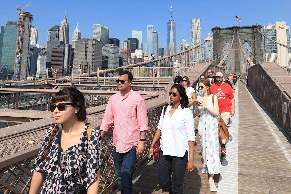 <p>People cross the Brooklyn Bridge on a beautiful day in New York City on Sept. 5, 2018. The only dangers now in photographing the site are tourists and fellow New Yorkers on bicycles. (Photo: Gordon Donovan/Yahoo News) </p>