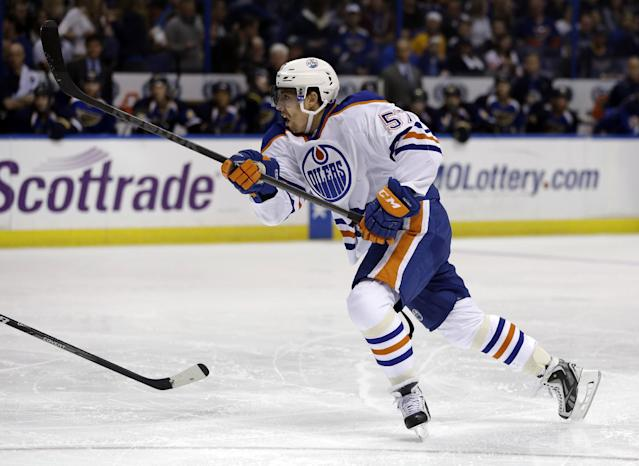 Edmonton Oilers' David Perron scores during the first period of an NHL hockey game against the St. Louis Blues, Thursday, March 13, 2014, in St. Louis. (AP Photo/Jeff Roberson)