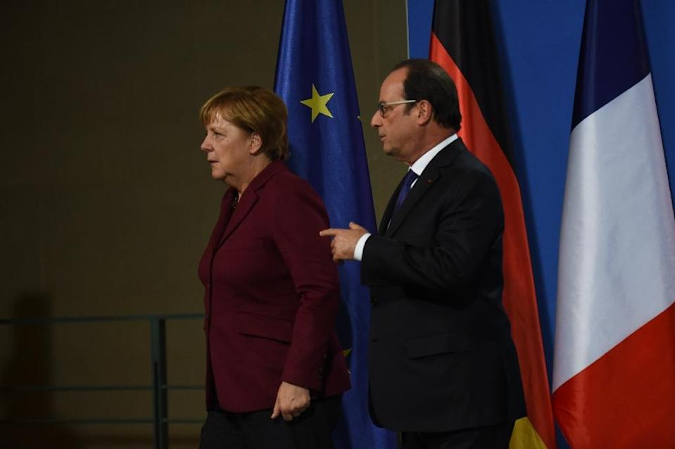 German Chancellor Angela Merkel and French President Francois Hollande leave a press conference after a meeting of the leaders of Russia, Ukraine, France and Germany (AFP Photo/Stephane de Sakutin)