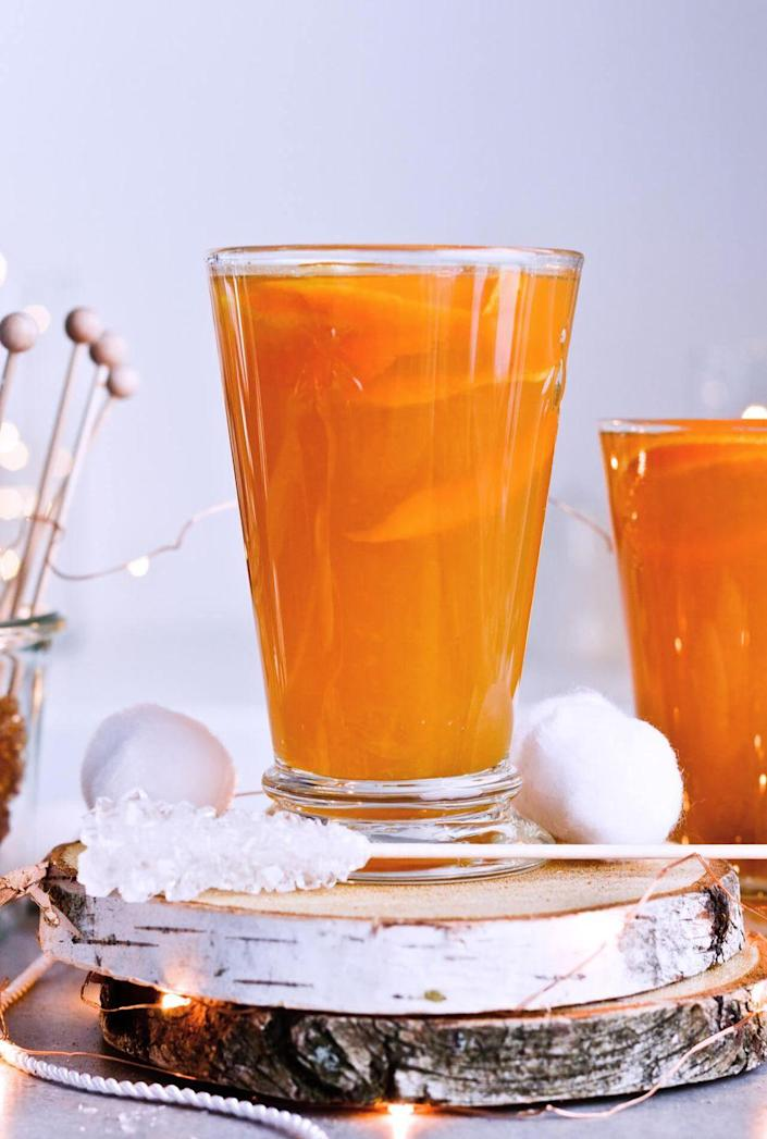 """<p>Use winter-inspired teas in this tasty punch recipe. Add in dark rum and ginger beer and you have yourself a warm, cozy punch.</p><p><strong>Get the recipe at <a href=""""https://www.sugarsalted.com/winter-tea-rum-punch/"""" rel=""""nofollow noopener"""" target=""""_blank"""" data-ylk=""""slk:Sugar Salted"""" class=""""link rapid-noclick-resp"""">Sugar Salted</a>.</strong> </p>"""