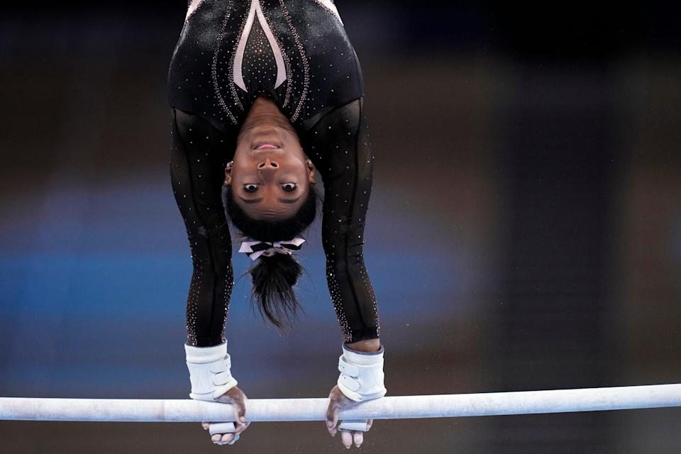 Simone Biles performs on uneven bars during podium training at the Ariake Gymnastics Center on Thursday, July 22, 2021, in Tokyo, Japan.