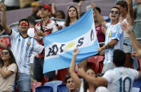 Argentina fans wave flags ahead of the Tri-Nations rugby test between Argentina and the All Blacks in Newcastle, Australia, Saturday, Nov. 28, 2020. (AP Photo/Rick Rycroft)