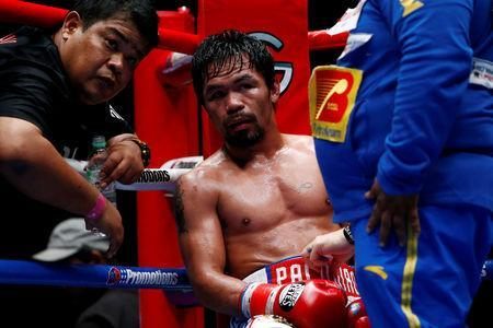 FILE PHOTO: Boxing - WBA Welterweight Title Fight - Manny Pacquiao v Lucas Matthysse - Axiata Arena, Kuala Lumpur, Malaysia - July 15, 2018 Manny Pacquiao looks on from his corner REUTERS/Lai Seng Sin/File Photo