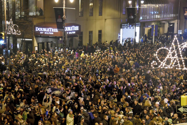<p>Fans celebrate near Broad and Locust streets in Philadelphia as the Philadelphia Eagles win the NFL Super Bowl 52 football game against the New England Patriots on Sunday, Feb. 4, 2018. The Eagles won 41-33. (Tom Gralish/The Philadelphia Inquirer via AP) </p>