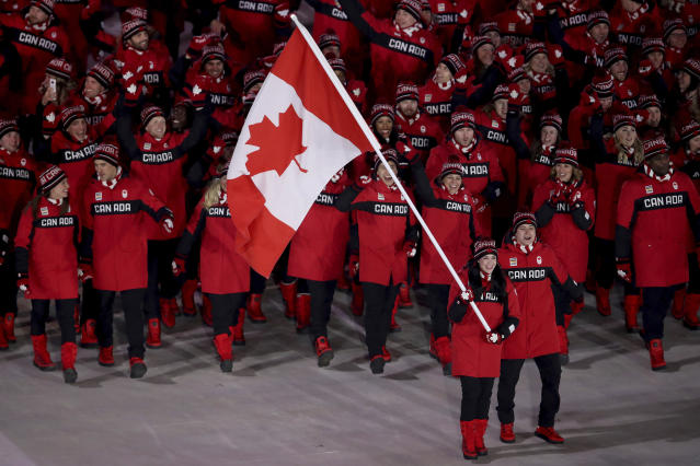 <p>Tessa Virtue carries the flag of Canada during the opening ceremony of the 2018 Winter Olympics in Pyeongchang, South Korea, Friday, Feb. 9, 2018. (Sean Haffey/Pool Photo via AP) </p>