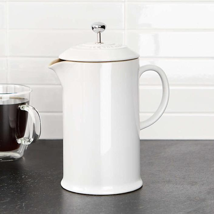 """This glossy French press is made of thick, durable stoneware with a stain- and scratch-resistant enamel glaze. It's also available in ink blue. $75, Crate & Barrel. <a href=""""https://www.crateandbarrel.com/le-creuset-white-french-press/s566343"""" rel=""""nofollow noopener"""" target=""""_blank"""" data-ylk=""""slk:Get it now!"""" class=""""link rapid-noclick-resp"""">Get it now!</a>"""