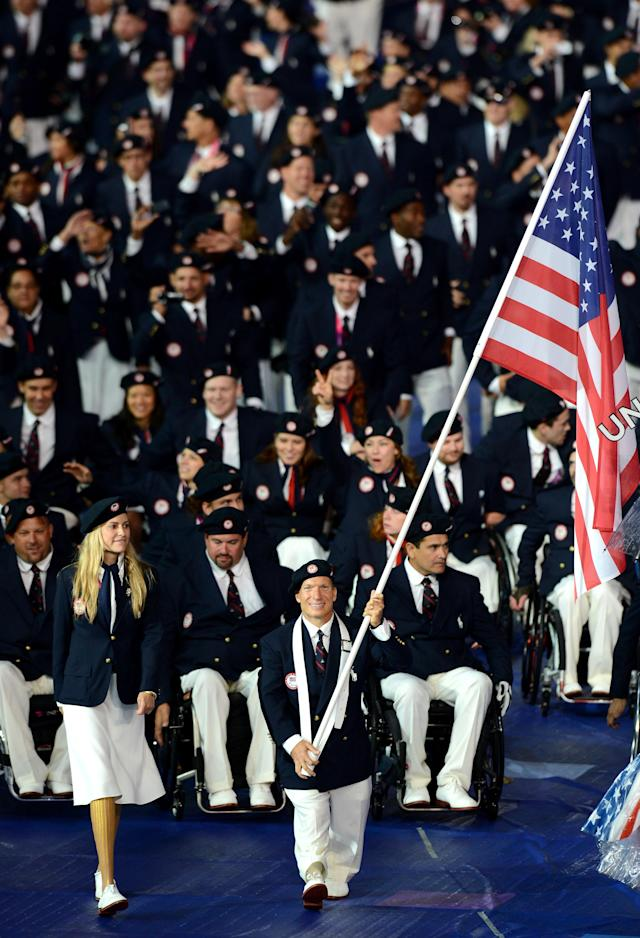 LONDON, ENGLAND - AUGUST 29: Athlete Scott Danberg of United States carries the flag during the Opening Ceremony of the London 2012 Paralympics at the Olympic Stadium on August 29, 2012 in London, England. (Photo by Gareth Copley/Getty Images)