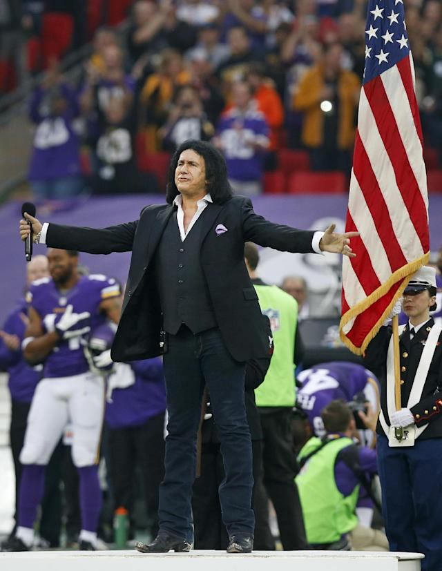Rock star Gene Simmons gestures after singing the US national anthem ahead of the NFL football game between the Pittsburgh Steelers and the Minnesota Vikings at Wembley Stadium, London, Sunday, Sept. 29, 2013. (AP Photo/Sang Tan)
