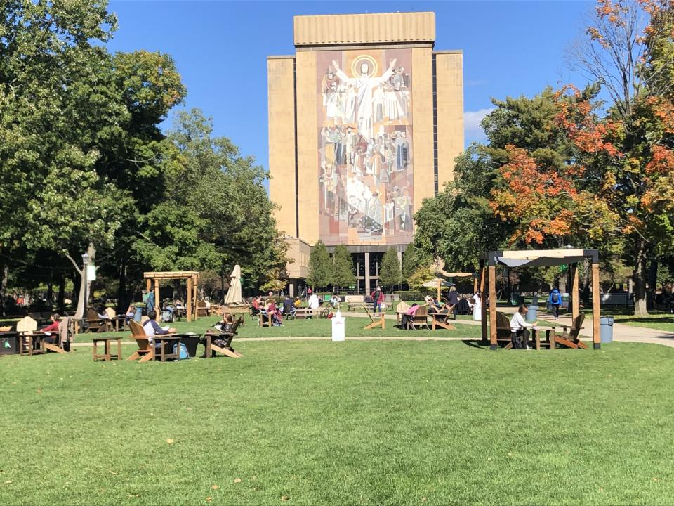 Students sit outside and take a break between classes on the campus of Notre Dame University in South Bend, Indiana on October 6, 2020. (Robert Chiarito/AFP via Getty Images)