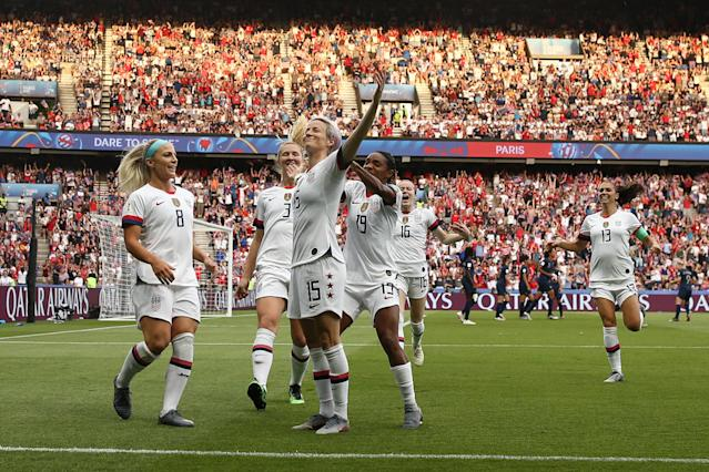 Megan Rapinoe of the USA celebrates with teammates after scoring her team's first goal during the 2019 FIFA Women's World Cup France Quarter Final match between France and USA at Parc des Princes on June 28, 2019 in Paris, France. (Photo by Joosep Martinson - FIFA/FIFA via Getty Images)