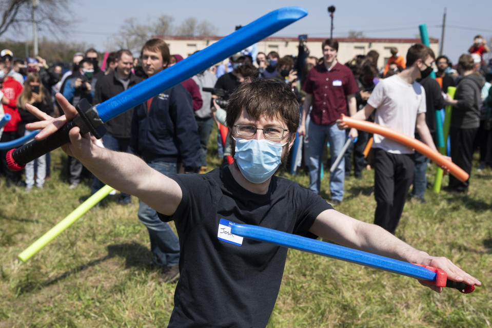 Joshs gathered to battle it out to find out who is the rightful owner of the name Josh via a pool noodle battle royale in an open green space in Air Park on Saturday, April 24, 2021, in Lincoln, Neb. What started as a mid-pandemic joke took on life Saturday, as a mixed bag of individuals sharing only their name came to battle it out. The winner was to be declared the rightful owner of the name. (Kenneth Ferriera/Lincoln Journal Star via AP)