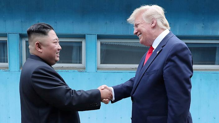 U.S. President Donald Trump shakes hands with North Korean leader Kim Jong Un as they meet at the demilitarized zone separating the two Koreas, in Panmunjom, South Korea, June 30, 2019. (KCNA via Reuters)