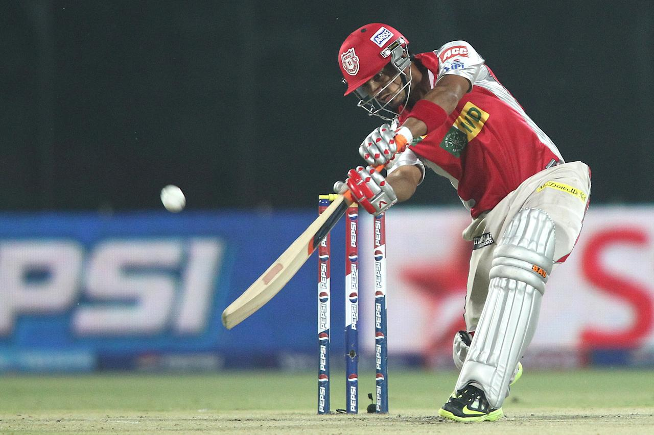 Mandeep Singh of the Kings XI Punjab hits over the top for a boundary during match 32 of the Pepsi Indian Premier League between The Delhi Daredevils and the Kings XI Punjab held at the Feroz Shah Kotla Stadium, Delhi on the 23rd April 2013..Photo by Shaun Roy-IPL-SPORTZPICS  ..Use of this image is subject to the terms and conditions as outlined by the BCCI. These terms can be found by following this link:..https://ec.yimg.com/ec?url=http%3a%2f%2fwww.sportzpics.co.za%2fimage%2fI0000SoRagM2cIEc&t=1498312079&sig=QcnT44xkJ7jAvROPJ1Q58g--~C