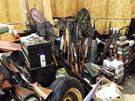 Stacks of guns are seen in a garage belonging to Brent Nicholson in Pageland, South Carolina, in this undated handout picture provided by the Chesterfield County (SC) Sheriff's Office. REUTERS/Chesterfield County (SC) Sheriff's Office/Handout via Reuters